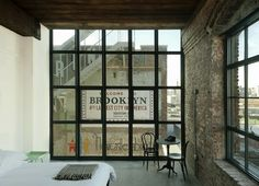A turn-of-the-century textile factory converted into a characterful 70-room boutique establishment on the Brooklyn waterfront in Williamsburg, Wythe Hotel oozes industrial cool: exposed distressed brick walls, cement floors, salvaged-timber-beamed ceilings, and floor-to-ceiling windows framing the iconic Manhattan skyline.