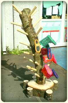 Wellie Tree or maybe a Boot Branch - a great way to store boots for outdoor play!