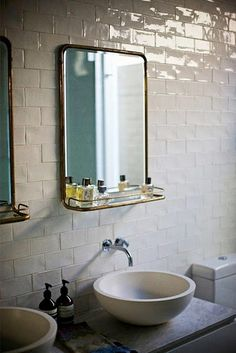 Mixing modern with vintage. The sinks and fixtures are very current while the mirrors are pure 50s