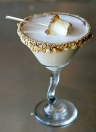 Smores martini!!     1oz Godiva Chocolate liquor  1/2 oz Creme de Cacao  2 oz Smirnoff Fluffed Marshmallow Vodka    5 good shakes in a martini tin with ice cubes  Rim glass in Chocolate syrup and crushed graham crackers.  Garnish with a toasted marshmellow on a tiny twig!  (way cuter than a martini pic)  TADAAA! Oh my gosh this looks amazing!!!