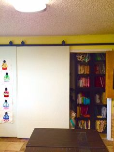 MY sewing room redo!  2 barn door style sliding design walls, have storage behind them and meet in the middle in case I want to have a large quilt on it.  My husband and I made them and they were cheap.  (angle iron for the rails and garage door pulleys for the rollers)