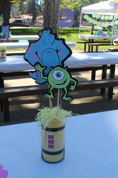 Monsters Inc Centerpiece I made with the my Cricut and The Best of Pixar cartridge. #monstersincparty #mikeandsully