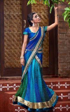 Blue-green half saree. Indian fashion.