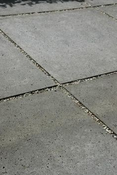 Replacing the rotting wood joints between the concrete slabs with pea gravel/pebbles.