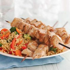 Tuna Skewers with Vegetable Rice. A simple teriyaki sauce mixture gives an Asian accent to these broiled tuna skewers served over a bed of vegetables and rice. Fish Recipes, Seafood Recipes, Healthy Recipes, How To Cook Tuna, Vegetable Rice, Tuna Steaks, Grilled Fish, Seafood Dinner, Stuffed Sweet Peppers