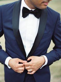 Groom looking sharp in a navy tuxedo: http://www.stylemepretty.com/2017/03/06/modern-sleek-indian-wedding/ Photography: When He Found Her - https://www.whenhefoundher.com/