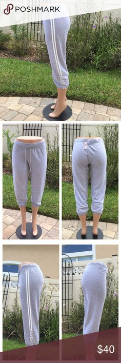 Victoria's Secret Pink Jogger Victoria's Secret Jogger. Grey color. On one side has the white stripe and Angle VS letters and the other side is plain. NWT. (The hoodie in the last picture is for show, if interested, please see my another list) (ask for bundle deal) Victoria's Secret Pants