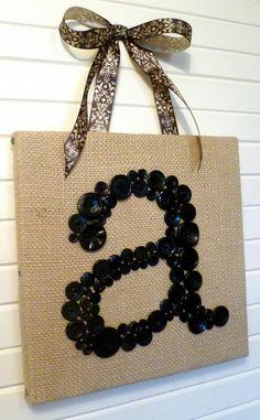 Button and Burlap Initial Decor DIY - how easy! And could be very cute in multicolor buttons! Combine letters on a wall to spell names or words!