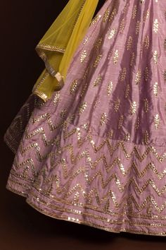 Dusky Orchid gotawork lehenga paired with mirror work blouse (unstitched) and sheer, lime net dupatta. Bridal Mehndi Dresses, Indian Gowns Dresses, Indian Bridal Outfits, Indian Designer Outfits, Designer Dresses, Shadi Dresses, Wedding Dress, Choli Designs, Sari Blouse Designs