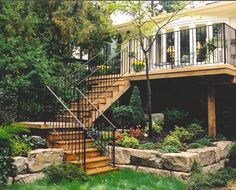 Elevated, second story deck with wide, turning staircase and landing. | yourdeck.ca