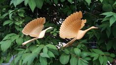Couple of fan carved cranes