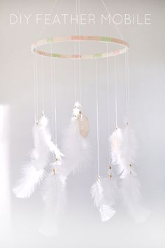 An easy tutorial for a super chic and cute DIY Feather Mobile perfect for the nursery!