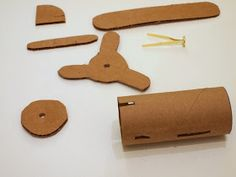 cut out cardboard pieces to make toilet roll airplane