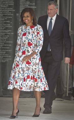 First lady Michelle Obama, followed by New York City Mayor Bill de Blasio, arrives for a r...
