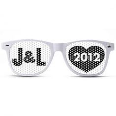 Y'alls intials + the year on Wayfarer-styled shades -- could be cute for attendants (think of the wedding party pics!) or as favors. From our sponsors at http://promovizion.com/shop/initial-year-package/