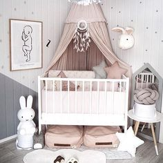 Crib in corner, draped fabric