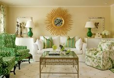 Green print wingback chairs, Striped pillows on white slipcovered couch