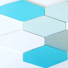 Pretty Spring Colors in our Basis 6x12 Long Hexagon floor tile. The colors shown are matte finish: Lunar white, Tropic turquoise, Oyster grey and Minty soft green. #madeinamerica #floortilefriday #modwalls #tiles #ceramics #hexagontiles #hex #midcenturymodern #modernhomes #floortile #walltile #instadesign #bathroomremodel #bathroomfloor