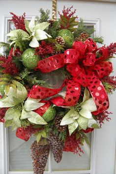 A gorgeous wreath to hang on you door this season!    This wreath has Christmas written all over it. All the gorgeous pine, light green with white
