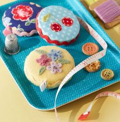 Pretty tape measure covers - pattern is in Quilts and More magazine Winter 2014 issue @ AllPeopleQuilt.com