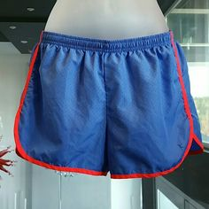 Danskin Now sports shorts Danson Now sport shorts Purple with neon pink trim. Small pocket inside. Drawstrings. Good conditon, worn twice. Size small,4/6 Pic#3 is an upcolse of material. 100%polyester Danskin Shorts