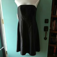 Black Strapless Ann Taylor formal Dress NWT NWT Ann Taylor dress. Very cute formal wear. Comes with straps if you prefer straps. Size 12. Original price $168. Has small bow creating an empire waist effect. Shell is 100% Silk. Ann Taylor Dresses Strapless
