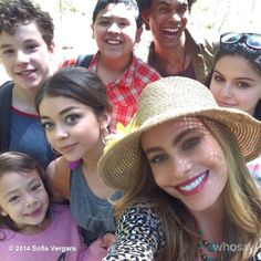 Modern Family cast. Who the hell are these random dudes that keep showing up in the background? LOL