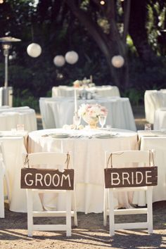 bride and groom wooden signs http://www.weddingchicks.com/2013/12/02/mccormick-home-ranch-wedding-3/