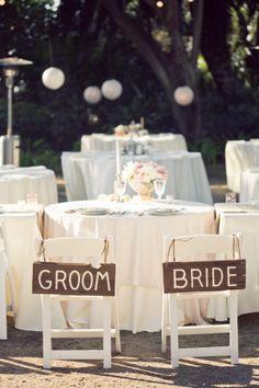 bride and groom wooden signs http://www.weddingchicks.com/2013/12/02/mccormick-home-ranch-wedding-3/