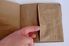 Great instructions, photos and video how-to for paper bag book. Could make a great art project!
