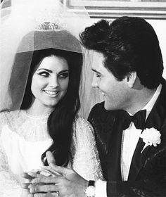 Elvis and Priscilla.  This is truly a sweet picture.  So young and so in love.  Everything was ahead of them at this moment.  If only... .