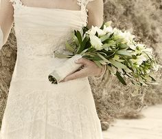 Special natural bouquet with lot of green olive leaves and white roses #weddingingreece #bridalbouquet #mythosweddings