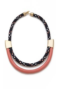 I love a great statement necklace and this one would be perfect to fancy up a white silk blouse.