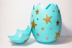 Oooh! Sparkly! Here's our giant mache egg gift box idea #easteregg #papermache #mache #giftbox