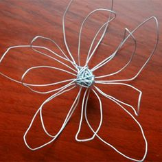 wire flowers... awesome! I wonder what they'd look like super sized and on my wall...