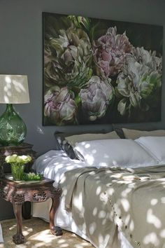 We love the large scale print above the bed - it's like a modern headboard! The floral subject and earthy color palette keep in tone with the natural hues of the bedroom.