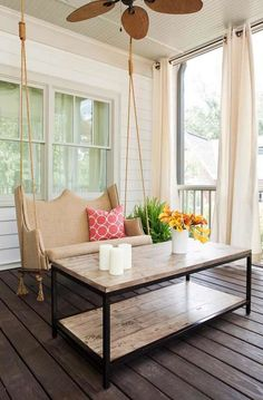 Take an old thrift store sofa, re-upholster it, cut the legs off, and make it into a porch swing. Genius!