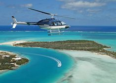 A photograph of a TCI Helicopters tour flying over Pine Cay and Fort George Cay, Turks and Caicos Islands.  Can I live here?