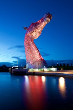 "Enormous horse head sculptures ""The Kelpies"" by artist Andy Scott Illuminate the Scottish Skyline at Night in Falkirk. Sculpture Metal, Horse Sculpture, Outdoor Sculpture, Art Sculptures, Futuristic Architecture, Beautiful Architecture, Steampunk Characters, Horse Head, Public Art"