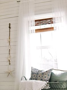 Create the illusion of a taller room by hanging curtains higher. Install rods close to the ceiling and hang long curtains that stretch all the way down to the floor. Helpful Hint: Make the windows look larger by hanging a rod that is much wider than the window. Then, arrange curtains so they cover just a small bit of the window frame and a large portion of the wall on either side. Photo courtesy of Layla Palmer.
