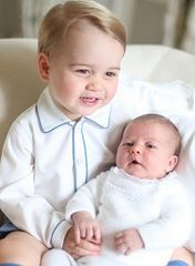 The royal family just released pics of Princess Charlotte being held by big brother, Prince George.