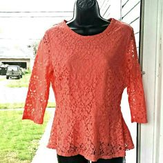 """3/4 Sleeved Peplum Top This top is a bright peachy orange color that will brighten up any day.! It's fully lined with an overlay of sheer flowers. The sleeves are the only part that's left unlined. They measure 14"""". There's an invisible side zipper so the top is flawless in the front & back.  It measures 23"""" from top to bottom & 14"""" at the bust. The perfect top for work or a night out!       # 0313   5/4 Kenar Tops Blouses"""
