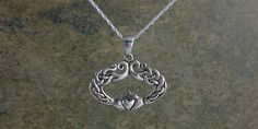 This uniquely designed Celtic Claddagh Necklace was created in Sterling Silver. The oval shape is encircled with Celtic Eternity knots that