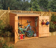 Bike shed. Would be super easy to build whatever size you need. Perfect when you don't have garage space.