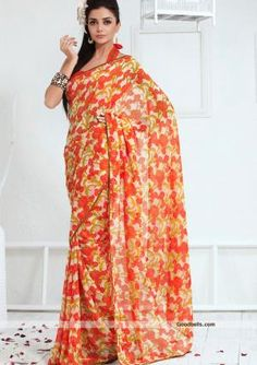Pretty off white georgette saree adorned with orange shade floral prints. Floral design sarees are best suitable for casual wear. $35.00 http://goodbells.com/saree/off-white-saree-with-orange-prints.html
