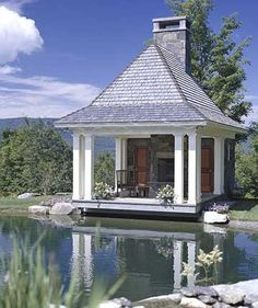 Pavilion with a Fireplace- I can just imagine summer nights with a warm fire roasting marshmallows and catching fireflies by the lake. This would be a dream!