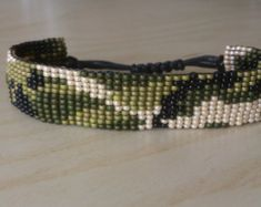 "Loom beaded bracelet ""camouflage"" ""army"" / Beaded bracelet with waxed cord Loom Bracelet Patterns, Bead Loom Bracelets, Loom Patterns, Beading Patterns, Bead Jewellery, Seed Bead Jewelry, Beaded Jewelry, Bead Loom Designs, Colorful Bracelets"