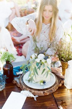 Boho bridal shower with a garnished cake