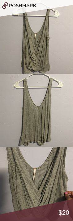 Free People wrap tank top Grey Free People wrap tank top. New without tags. Very versatile, can be worn casually with jeans and sandals or dressed up with some heels. Free People Tops Tank Tops