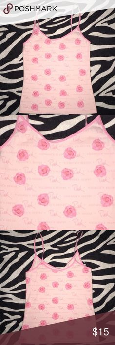 VS Pink Spaghetti Strap Top Super cute VS Pink Spaghetti Strap Top with Victoria's Secret Pink written all over it with roses! Only worn twice so it's In perfect condition no rips or stains! PINK Victoria's Secret Tops Camisoles